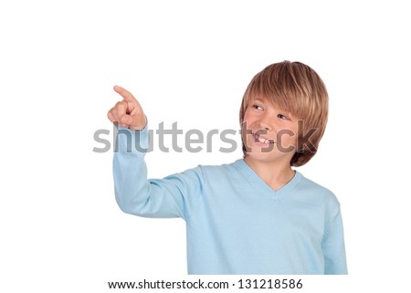 Happy preteen boy pointing something isolated on a over white background - stock photo