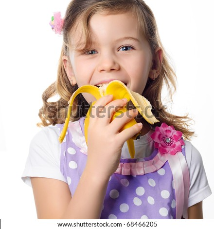 happy pretty girl eating banana on white background - stock photo
