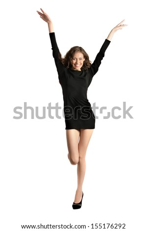Happy pretty young woman in black dress smiling on white background. Celebrating success - stock photo