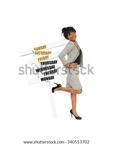 Happy Professional woman kicking over directional arrow signs post with (Monday, Tuesday, Wednesday, Thursday, Friday, Saturday, Sunday) - stock photo