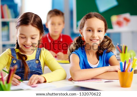 Happy pupils enjoying their day at elementary school - stock photo