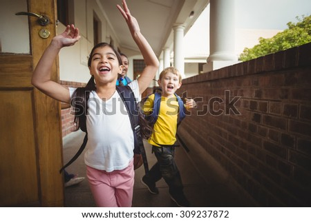 Happy pupils leaving the classroom in school