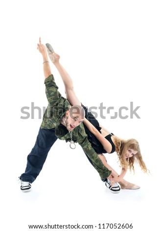 Happy rapper and gymnast girl depict triangle isolated on white background. Man points his finger up, woman raised one leg up. - stock photo