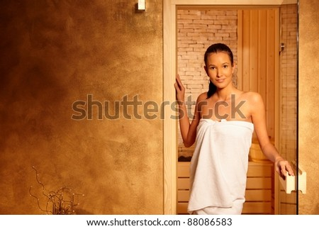 Happy relaxed woman leaving sauna, smiling after healthy steam on wellness.? - stock photo