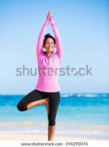 Happy relaxed young woman practicing yoga outdoors at the beach. Healthy natural lifestyle. - stock photo