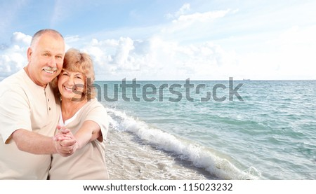 Happy relaxing couple on the beach. Resort.