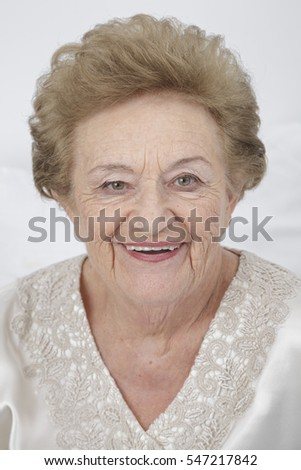 Happy retired old woman