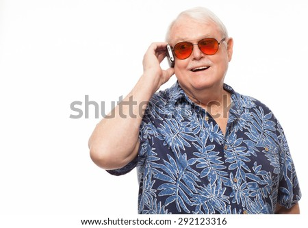 Happy retired senior man on mobile phone with copy space. - stock photo