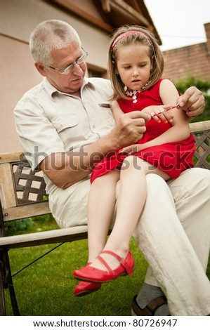 Happy retirement - grandparent with grandchild - stock photo