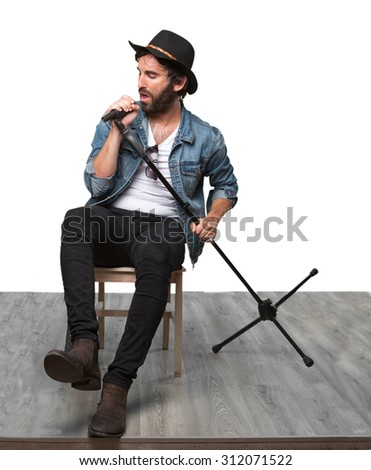 happy rockstar with microphone - stock photo