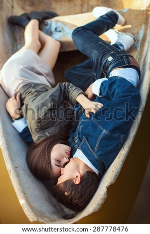 Happy romantic couple rowing a small boat on lake