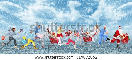Happy running Christmas people over snowy background - stock photo