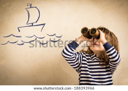 Happy sailor kid playing indoors. Smiling child look at drawing ship. Travel and adventure concept. Summer vacation - stock photo