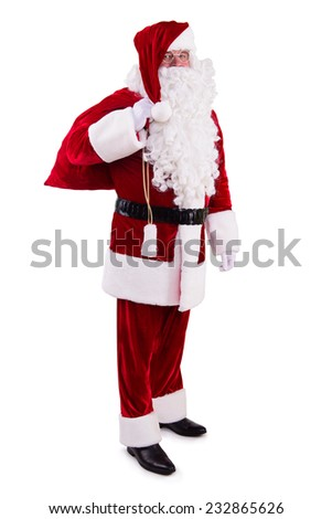 happy Santa Claus with big bag. Isolated on white background - stock photo