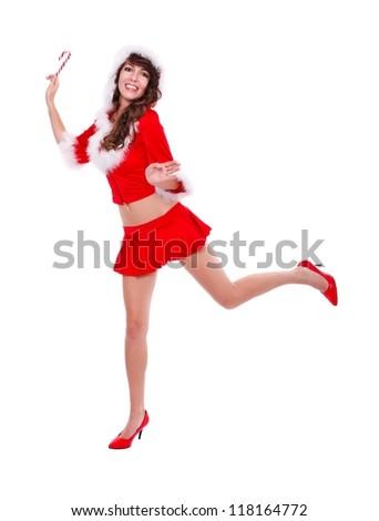 Happy Santa helper with lollypop in hand, studio shot - stock photo