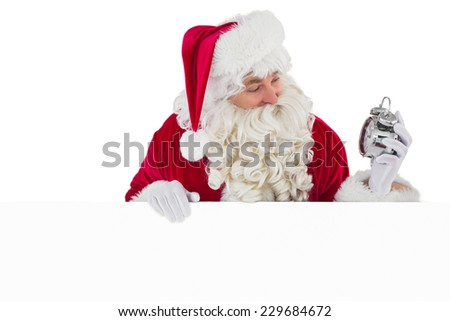 Happy santa holding alarm clock and sign on white background