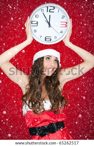 happy santa woman holding clock on red background - stock photo