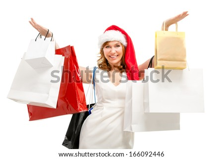 Happy santa woman with bags. Christmas shopping. - stock photo