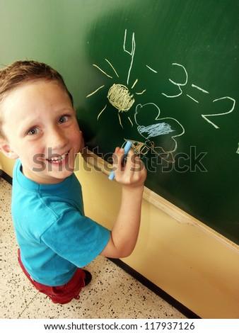 Happy school boy on blackboard, - stock photo
