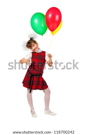 Happy school girl is standing with colorful balloons in his hand on a white background.