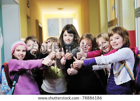 happy school girls running outdoor at sunny autumn day - stock photo