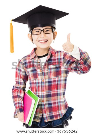 happy school kid in graduation cap with thumb up