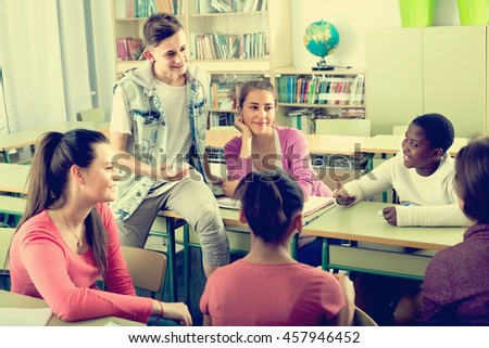 happy school pupils taking a rest together indoors - stock photo