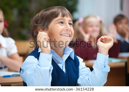 Happy schoolboy. Real lesson in classroom - stock photo