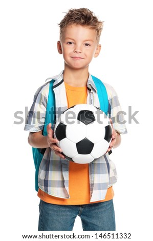 Happy schoolboy with backpack and soccer ball, isolated on white background - stock photo