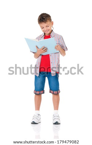 Happy schoolboy with books isolated on white background - stock photo