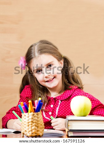 Happy schoolgirl have a nice time in the classroom - stock photo