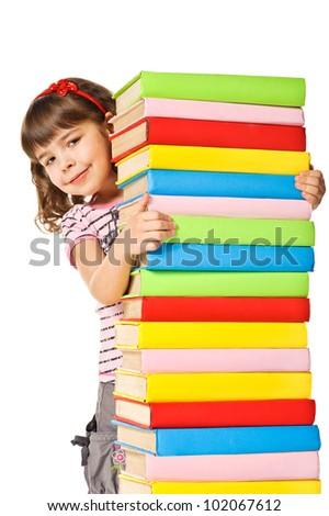 Happy Schoolgirl holding pile of books. Isolated over white - stock photo