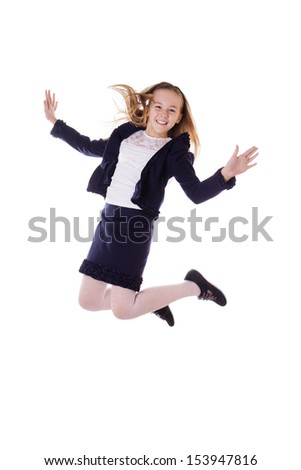 Happy schoolgirl in uniform jumping on white background, in motion