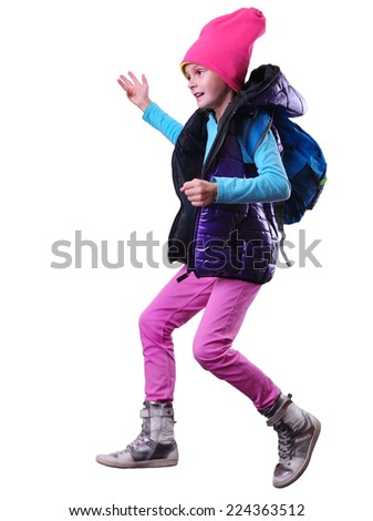 Happy schoolgirl  with a backpack and hat  exercising, running and jumping. Isolated over white background.  - stock photo