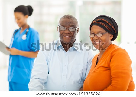 happy senior african couple in doctors office - stock photo