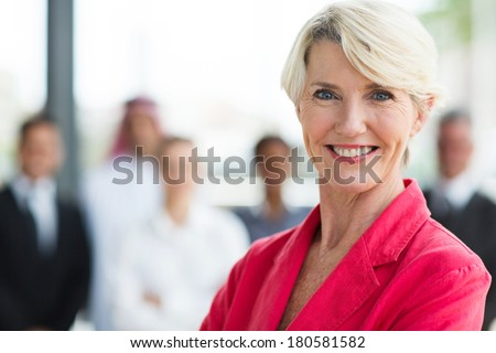 happy senior businesswoman looking at the camera - stock photo