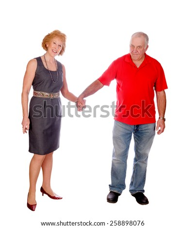 Happy senior Caucasian couple holding hands, isolated on white - stock photo