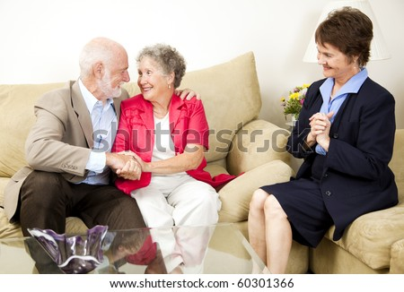 Happy senior couple benefits from marriage counseling. - stock photo