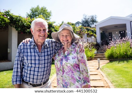 Happy senior couple embracing in the garden - stock photo