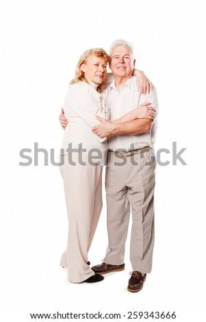 Happy senior couple embracing together. Isolated on white background. - stock photo