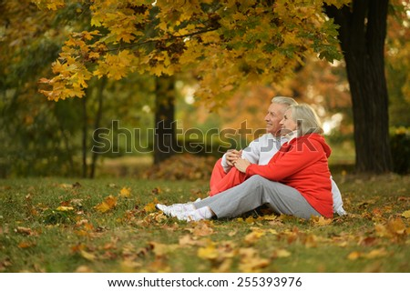 Happy senior couple in autumn park - stock photo