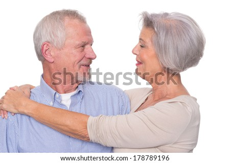 Happy senior couple in front of white background