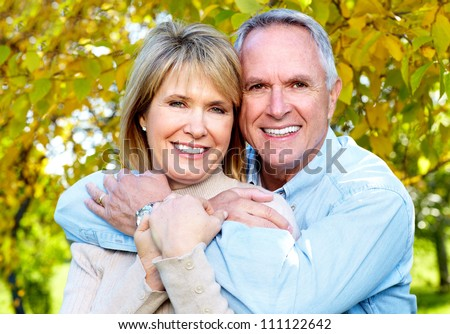Happy senior couple in love. Park outdoors. - stock photo