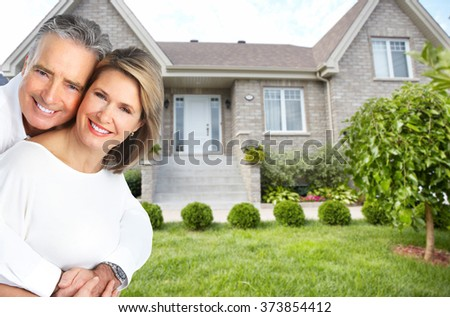 Happy couple near new house stock photo 367255868 shutterstock - Young couple modern homes ...