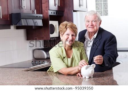 happy senior couple saving for retirement - stock photo