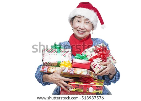 Happy senior lady with christmas gifts. Isolated in white background.