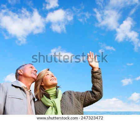 Happy senior loving couple over nature background - stock photo