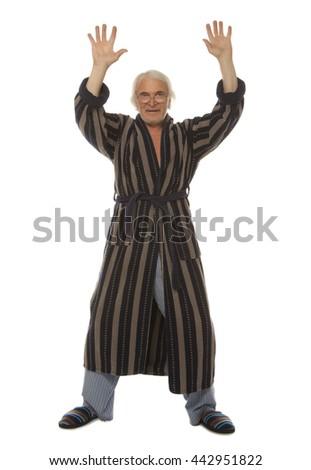 Happy senior man doing chinese qigong gymnastics isolated on white background - stock photo