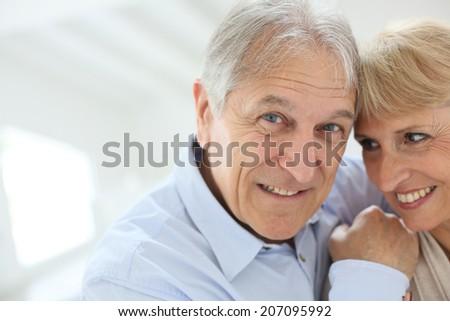 happy senior man embracing his wife - stock photo