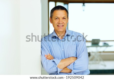 Happy Senior Man With Hands Folded at home - stock photo